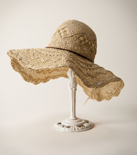 Surf O'Neill Sunrise Sun Hat.  Paper straw sun hat; specialty woven pattern; faux suede band with feathers and wooden beads; logo metal charm.As Seen In Coastal Living Magazine April 2012 Issue!! - $20.99