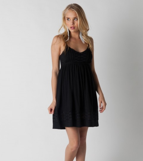 Surf O'Neill Fast Times Dress.  55% Cotton / 45% Modal.  Eyelette insets along bottom and front chest; pintucking details; crochet trim along bust; strap adjusters; smocked back; metal logo badge. - $29.99