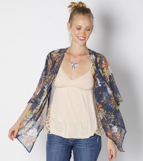 Surf O'Neill Dandy Shirt.  100% Polyester chiffon printed.  Open style cardigan; 3/4 flutter sleeve; metallogo badge. - $33.99