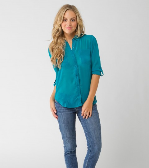 Surf O'Neill Galaxy Top.  100% Polyester chiffon printed.  Plastic pearlized buttons; convertible sleeve; saddle cut hem; metal logo badge. - $36.99