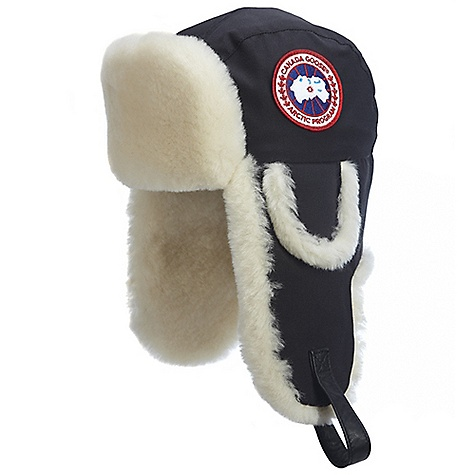 Entertainment The Canada Goose Arctic Pilot Hat will you keep you flying High with ultimate warmth. The internal sheepskin shearling keeps your dome nice and cozy while the Arctic-Tech fabric with DWR finish keeps it dry. And if you can believe it, the Arctic Tech Shearling Pilot Hat has not just one set of earflaps, but two! This hat stands up to the most extreme weather conditions. If your ears long for fresh air, this Canada Goose hat also Features a leather chinstrap to raise the earflaps. Offered in two sizes, the Canada Goose Arctic Tech Pilot Hat is sure to Fit that huge brain of yours! Features of the Canada Goose Arctic Tech Shearling Pilot Hat Internal reflective tape at seams Water-resistant Artic-Tech fabric exterior for durability and weather-resistance Adjustable leather chinstrap with metal buckle that can be used to raise the earflaps Secondary earflaps for extended comfort and weather protection Front shearling section can be dropped for further protection via a set of ring snaps Canada Goose disc at left side and Wordmark label at centre back - $250.00
