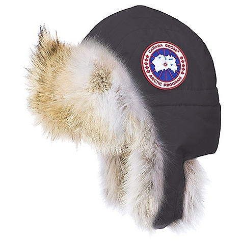 Entertainment The Canada Goose Aviator Hat might as well be called the Coyote Hat. Why, you ask? This Canada Goose hat Features a coyote fur ruff visor and earflaps, a turn-of-the-century feature that was used to keep pilots warm in open cockpits. Maybe you won?t find yourself flying in any open cockpits, but you will find yourself fully protected from the elements in this hat. Coyote fur never freezes or holds water. Paired with the water-resistant Arctic-Tech fabric exterior, The Coyote?err, I mean Aviator Hat keeps your head warm, dry, and safe from chilly winds. Features of the Canada Goose Aviator Hat Water-resistant Arctic-Tech fabric exterior for durability and weather resistance Coyote fur ruff visor and ear-flaps Are a turn-of the-century functional feature that kept pilots warm in an open cockpit at High speeds Adjustable buckle chin strap for High wind or High speed action 2 1/2in. Canada Goose disc on left side Natural coyote fur - $250.00