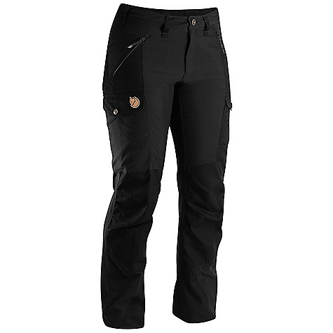 Camp and Hike The Fjallraven Women's Nikka Trouser is a Technical pant for hiking and Climbing. The G-1000 fabric is durable with a touch of elastane to help you move with ease. Reinforced at the seat, knees and cuffs, they'll hold up to constant trail use. The Fitted shape won't leave your fashion sense behind while still allows for proper bending and movement through the crotch. The waist Features a Higher back to prevent packs from rubbing the wrong way and zippered hand pockets secure Items so they won't fall out mid-climb. They're even accessible while wearing a pack. Tuck any extra Items in the tHigh pockets and rock the outdoors. Features of the Fjallraven Women's Nikka Trouser Trekking trouser in stretch and G-1000 that gives you freedom of movement and durability G-1000 reinforcement at butt, knees and leg ending Extra High back rise and pre shaped knees 2 hand pockets, 1 big leg pocket, 1 smaller inner mesh pocket and 1 pocket for cellphone or gps - $169.95
