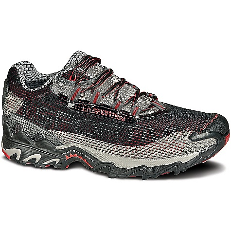 The La Sportiva Men's Wildcat Shoe is a trail running shoe for cushion on medium to tough terrain. The Wildcat Uses a single Density Midsole to provide plenty of cush as you hit mile after mile of trail. The shoe is a stable and neutral runner with grip for uneven dirt. The medium-wide Fit leaves plenty of space for your foot while the honeycomb mesh lining in the heel and tongue keep your feet dry as you sweat. An AirMesh Upper with trail cage allows additional breathability and a barrier against rocks and debris from tearing up the outsides. Power through your workout with the grippy FriXion AT Outsole with Impact Brake System to help control your slow down. Features of the La Sportiva Men's Wildcat Shoe Simple one-piece Upper with a protective wear-resistant mesh trail cage 2.4mm LaSpEVA lasting Board for sublime out-of-the-box cushioning Foot-wrap lacing harness provides a secure, stable Fit for every type of foot A stable neutral, extremely well cushioned trail running shoe La Sportiva's most cushioned trail running shoe - $110.00