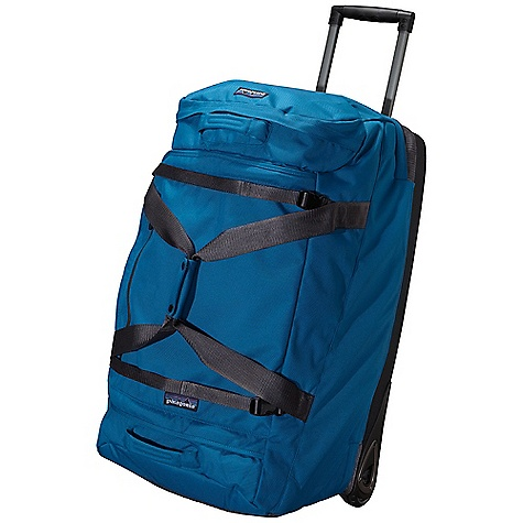 Entertainment Free Shipping. Patagonia Freewheeler Gear Bag DECENT FEATURES of the Patagonia Freewheeler Gear Bag Main compartment holds a week's worth of clothes fully lined lower compartment separates boots and gear from clothing floating baffle allows the load to expand into either compartment zippered end compartment for easy-access items interior mesh pocket for toiletries Light-colored lining makes contents easy to find Smooth-rolling 80mm wheels provide plenty of clearance Molded bottom pan resists abrasion and protects contents impact resistant skid plates Two-position retractable handle makes steering easy haul handles at either end; external compression straps storable business card holder Batten supports on sides keep bag standing and collapse for easy storage The SPECS Weight: 156 oz / 4423 g Volume: 4027 cubic inches / 66 liter Body: 11-oz 1,200-denier 100% recycled polyester Base: molded foam and 11-oz 1,200-denier 100% recycled polyester Lining: 3.3-oz 200-denier 100% polyester All treated with a polyurethane coating and a Deluge DWR (durable water repellent) finish This product can only be shipped within the United States. Please don't hate us. - $399.00