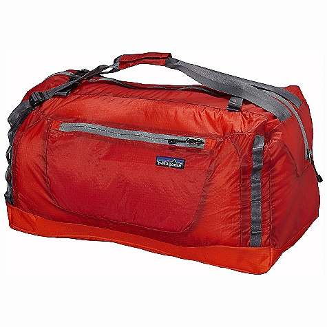Entertainment Free Shipping. Patagonia Lightweight Travel Duffel DECENT FEATURES of the Patagonia Lightweight Travel Duffel Extremely lightweight double-ripstop fabric features excellent tear resistance Large main compartment Zippered side pocket with internal key clip for small essentials Webbing duffel handles convert to pack straps for hands-free use on the go Top-mounted, dual-adjust webbing straps secure and compress the load Stuffs into its own pocket Internal webbing loop allows for easy merchandising on shop peg hooks The SPECS Weight: 8.5 oz / 241 g Volume: 2136 cubic inches / 35 liter Body: 1.8-oz 40-denier 100% nylon double-ripstop with a polyurethane coating and silicone finish Base: 6.3-oz 210-denier 100% nylon double-ripstop with a polyurethane coating This product can only be shipped within the United States. Please don't hate us. - $69.00