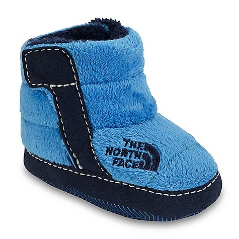 The North Face Infant Boys' NSE Fleece Bootie DECENT FEATURES of The North Face Infant Boys' NSE Fleece Bootie Upper: Soft, warm and durable high loft fleece upper 200 g Heatseeker insulation Medial and lateral Velcro instep tabs Bottom: Soft, flexible and forgiving synthetic bottom provides room for fast-growing feet The SPECS Last: VI-001 Approx Weight: 1/2 pair: 1 oz / 30 g, pair: 2 oz / 60 g This product can only be shipped within the United States. Please don't hate us. - $29.95