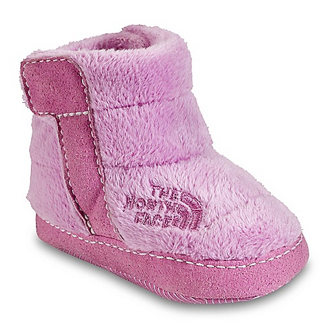 The North Face Infant Girls' NSE Fleece Bootie DECENT FEATURES of The North Face Infant Girls' NSE Fleece Bootie Upper: Soft, warm and durable high loft fleece upper and lining 200 g Heatseeker insulation Medial and lateral Velcro instep tabs Bottom: Soft, flexible and forgiving synthetic bottom provides room for fast-growing feet The SPECS Last: VI-001 Approx Weight: 1/2 pair: 1 oz / 30 g, pair: 2 oz / 60 g This product can only be shipped within the United States. Please don't hate us. - $29.95