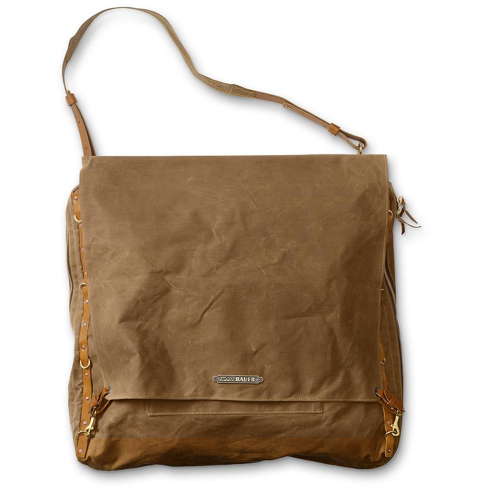 Flyfishing Eddie Bauer Packhorse Garment Bag - Being a down-to-earth guy, Eddie wouldn't fly. Most of his traveling was to various hunting and fishing spots in the Pacific Northwest. But for those who do take to the skies or even the road, this bag brings the essence of the rugged outdoors into airport terminals and hotel lobbies. Creating a unique character, each one varies slightly in color. Imported. - $199.99