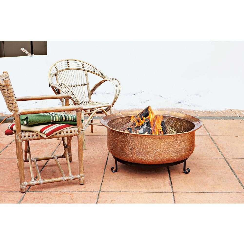 "Camp and Hike Eddie Bauer Copper Fire Pit - Bring the spirit of camping in the great outdoors right to your backyard or patio. The hammered copper bowl contains the flames while providing a luminous surface that ages beautifully. Includes a wrought iron stand and grate. Dimension: 16.5"" tall; 35"" diameter. Imported.  Standard shipping only. Expedited shipping unavailable for this item. - $199.99"