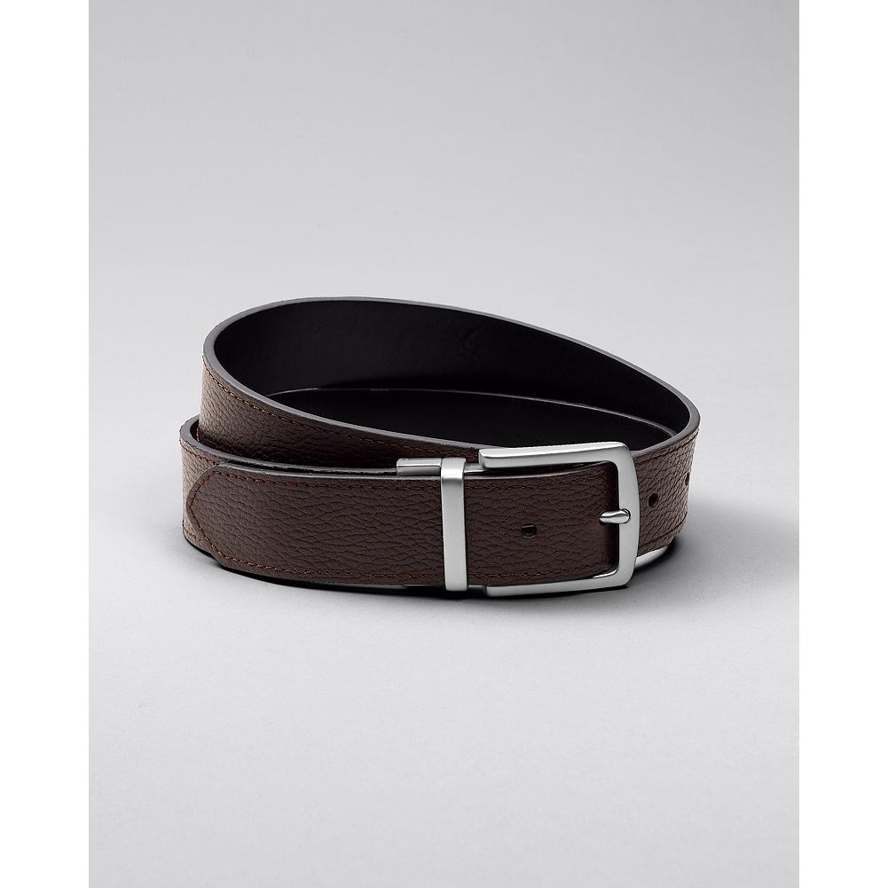 Eddie Bauer Everyday Reversible Leather Belt - Get two great casual leather belts for the price of one. The brown side is tumbled to create a rich, pebbled texture, and features accent stitching at the edges. The black side is smooth-finished, without stitching, for a clean, modern look. To reverse, simply grasp the strap and buckle in each hand, pull, and rotate. - $50.00