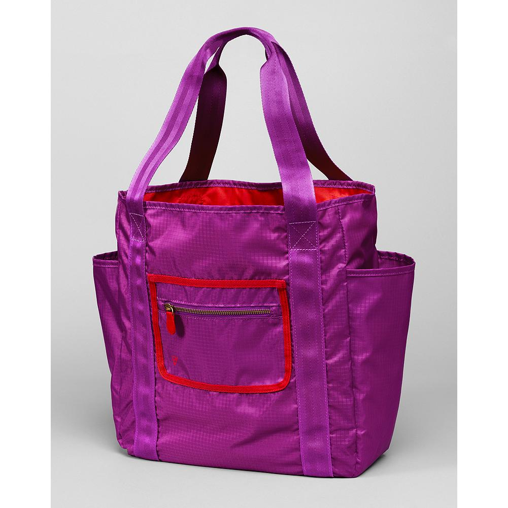 Eddie Bauer Organizer Tote - Deep main compartment, plus small exterior zip pocket for cell phone, keys and more. Slip pocket on both sides are sized for larger items (think water bottles). Black tote has matching black trim; purple tote has contrasting red trim. - $24.99