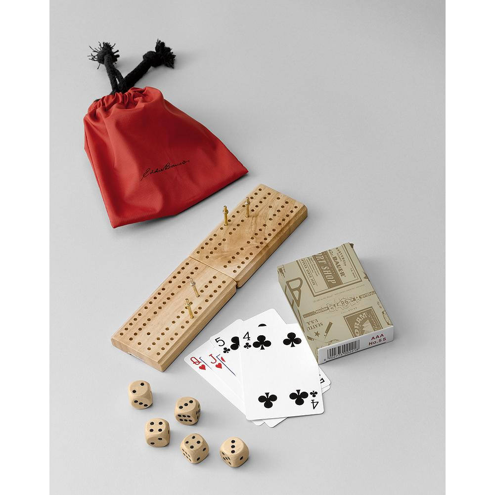 Entertainment Eddie Bauer 12-in-1 Game Set - Game set includes dominoes, sliding-lid cribbage board with pegs, deck of cards, 5 wooden dice, and instructions for 12 different games. - $4.99