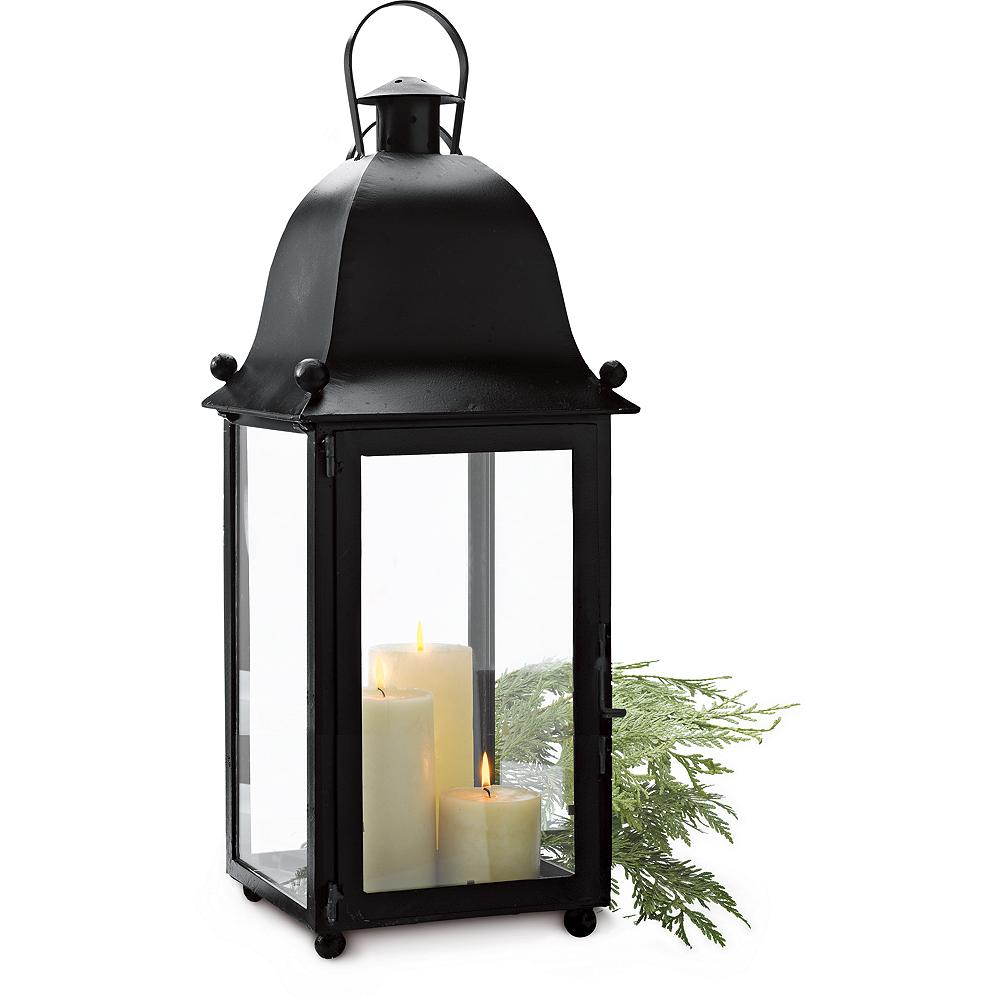 "Entertainment Eddie Bauer San Juan Lantern - Make a statement with our large, beautifully crafted, iron lantern. Four candles in various sizes cast a warm glow: 4""x4""; 3""x6""; 4""x8""; and 3""x9"". Glass panes. - $129.99"