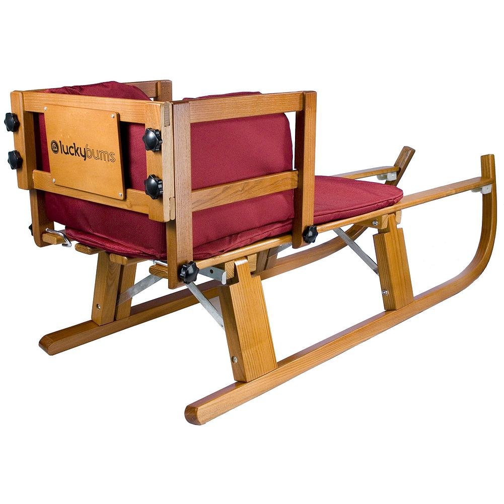 "Fitness Eddie Bauer luckybums Wooden Pull Sled - This classic, beautifully made sled features a comfortable padded cushion and back rest and reinforced stainless steel runners that are built to glide upon terrain of all kinds. Sled easily folds in half for storage or transport after back rest is removed. Measures 43""L x 13""W. Weight capacity: up to 200 lbs. - $79.99"