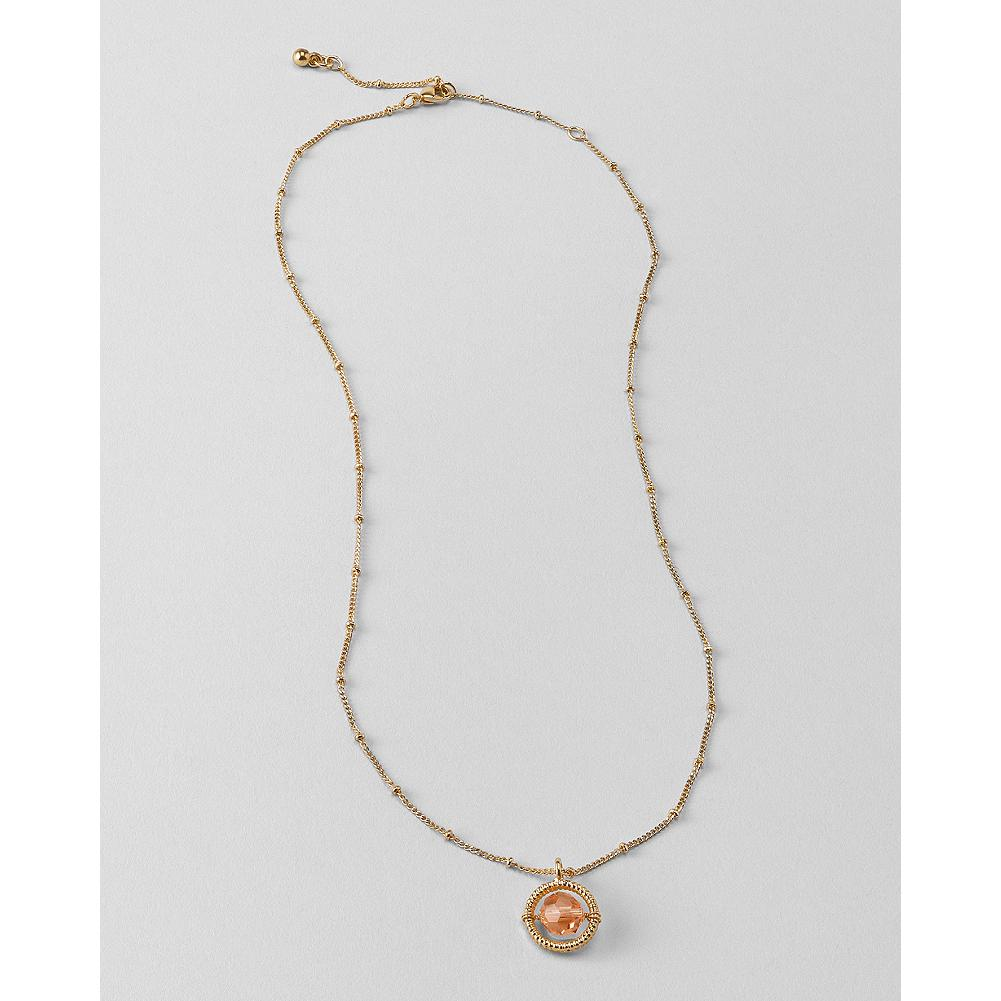 Entertainment Eddie Bauer Circle Frame Pendant - A beautiful glass bead pendant hangs from a delicate chain embellished with tiny spaced beads. - $19.99