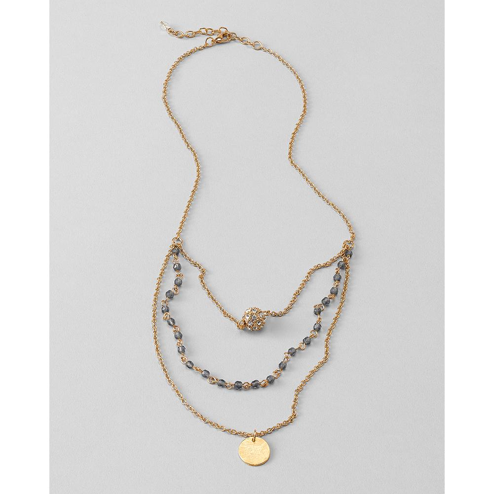 Entertainment Eddie Bauer Three-Strand Pendant Necklace - This versatile multi-strand necklace features sparkling crystal and gleaming gold-tone pendants interspersed with a row of glittering glass beads. - $19.99