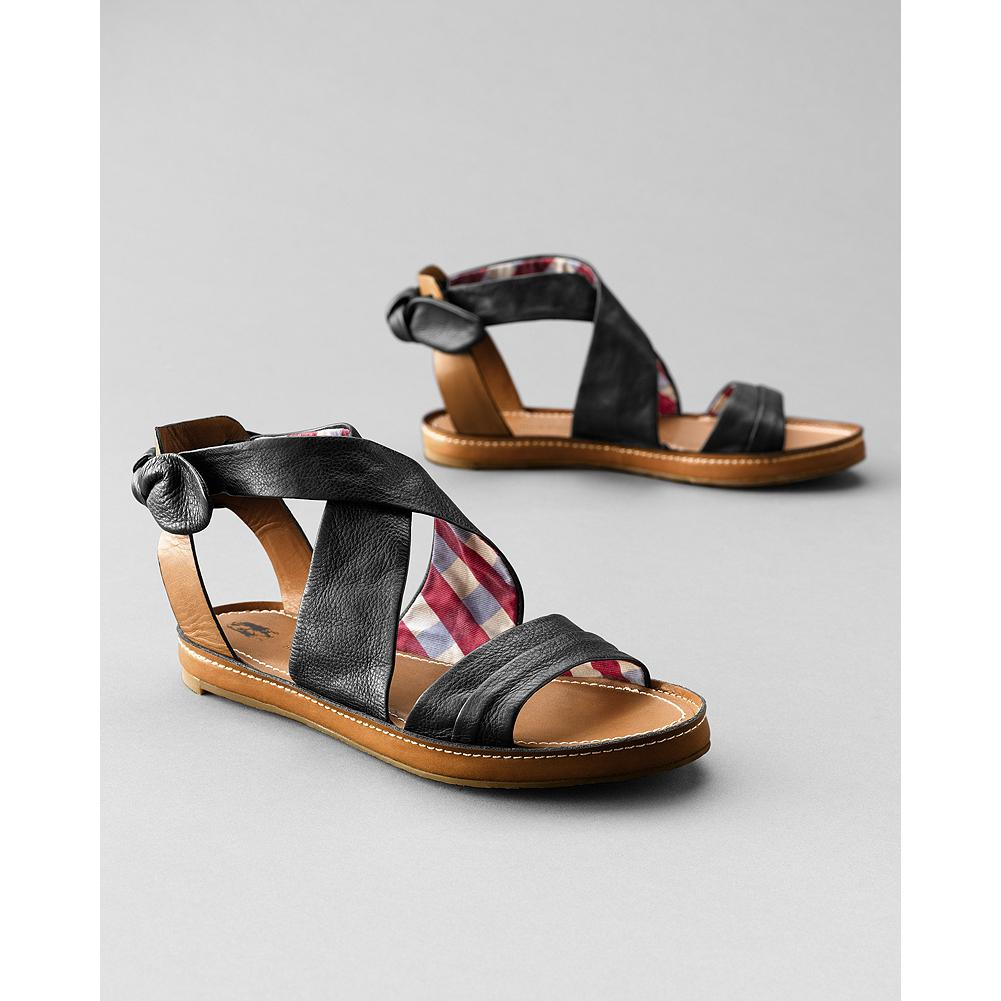 Entertainment Hush Puppies Regard Sandals - On-trend charm, with flirty back-ankle bows and fabric lining. Leather-wrapped EVA midsole and cushioned leather liner. Upper is suede (Brown, Blue) or full-grain leather (Black). Rubber sole. Imported. - $39.99