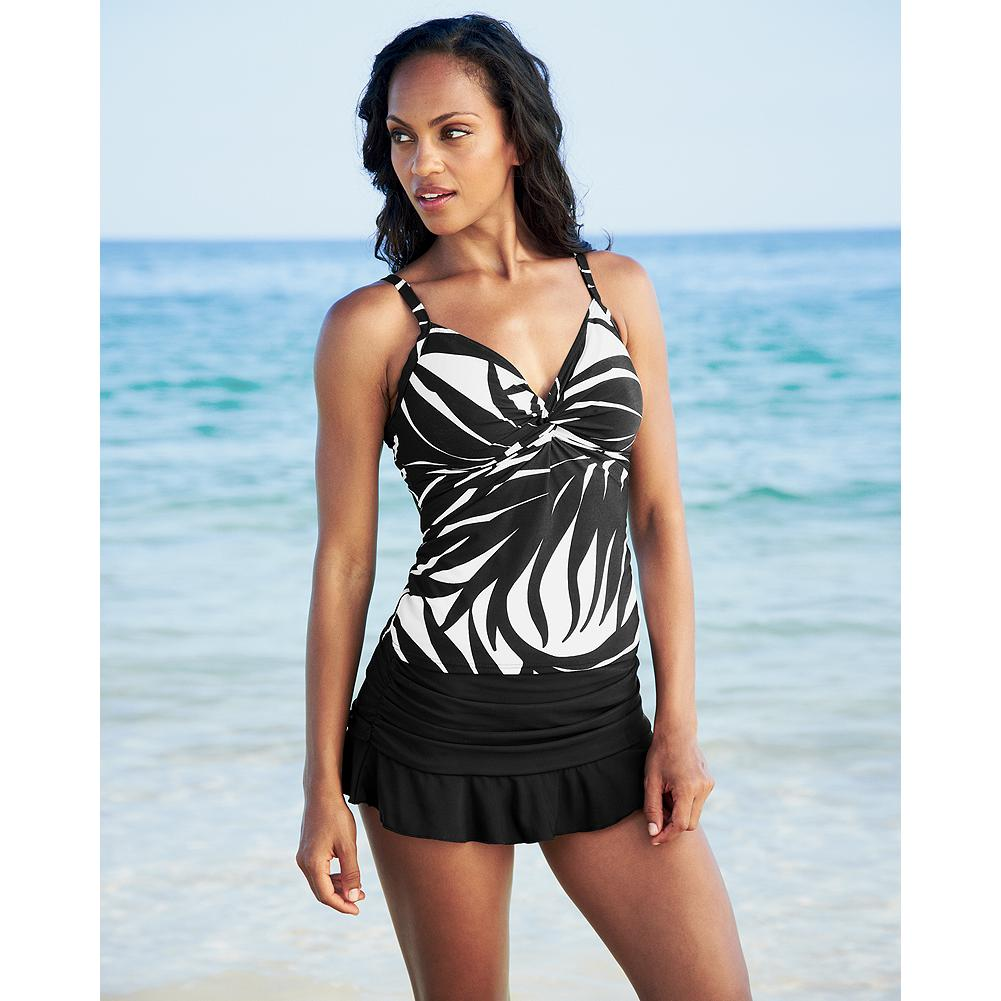 "Fitness Miraclesuit Ruched Swim Skirt - Discover the revolutionary support and curve control of Miraclesuit Miratex and look 10 pounds lighter in 10 seconds. Built-in panty. Length: 10 3/4"". USA/imported.  First time purchasing a Miraclesuit? Many customers order one size larger than their usual size. Please look at our size chart to find out the best fit for you. View Size Chart.               Watch Product Demo - $29.99"
