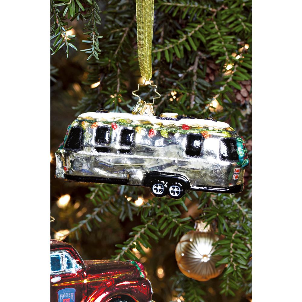 Entertainment Radko Airstream Ornament - The Eddie Bauer Airstream ornament celebrates the adventurous spirit of two American icons. With its colorful lights and dusting of snow, the trailer's all set for a holiday on the open road. Imported. - $24.99