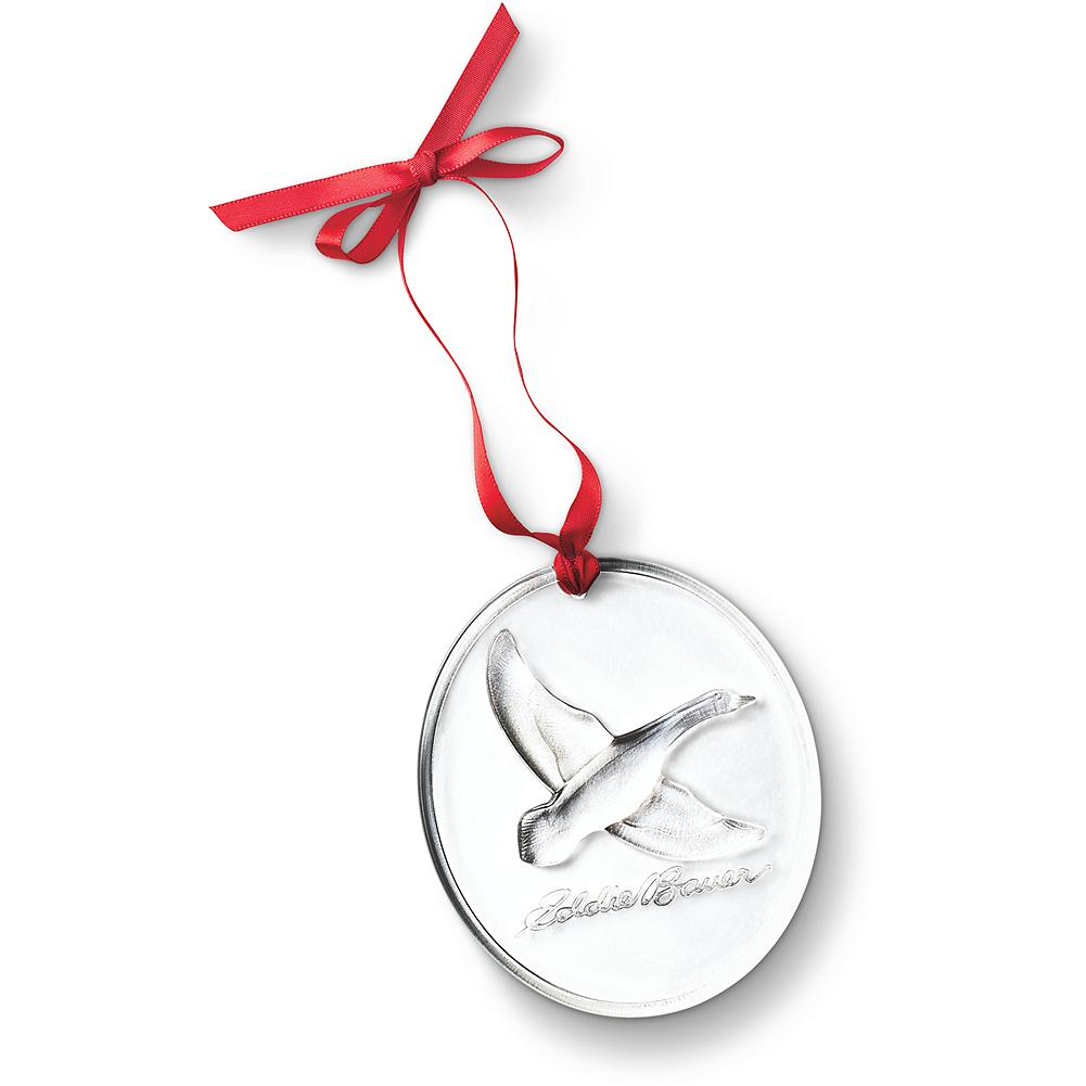 Entertainment Steuben Goose Ornament - This beautiful lead-crystal ornament was made especially for us by Steuben, the premier art glass manufacturer in the United States. A pure crystal disk is etched with a flying Canada goose, the heart of our logo, and a symbol of Eddie's love for the outdoors. Made in USA. - $19.99