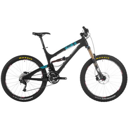 MTB We've witnessed the All-Mountain sect grow significantly over the years. This, however, resulted in designers having to choose between either an XC-focused, 32mm-stanchion fork or freeride-intended 36mm. Fox Racing Shox has thankfully filled that gap with its line of 34mm forks, like the one mated to this trail devouring Yeti SB-66 Carbon Race 34 Complete Bike. The six-inch travel Yeti SB-66 C expands on the quickly building reputation of Yeti'''s Switch Technology suspension by adorning it with a weight-dropping and stiffness-enhancing carbon chassis. In fact, the hand-laid high modulus carbon front and rear triangles knock a whopping pound and a half off its aluminum counterpart -- and that'''s without sacrificing anything to the stiffness department. That'''s right; you'''re looking at a trail bike with a six pound (2.72kg), six-inch travel frame. This is the first Yeti SB (Super Bike) series frame to feature collet-type pivot hardware, which ensures the correct bearing preload while protecting the structural integrity of the carbon fiber. Enduro Max angular contact bearings fill the bores and offer ultra-tight, flex-free tolerances while easily managing side loads that would send conventional cartridge bearings straight to the dump. The heart of the SB line lies in the suspension design. Unlike multi-link systems, which require linkages packed in between the main triangle and rear triangle, Yeti'''s Switch Technology features an eccentric mechanism buried low in the frame -- enabling super-short chain stays and a low center of gravity for lively handling. This compact eccentric continuously adjusts the lower pivot position for a rearward, small-bump-damping axle path while maintaining a firm, pedal-friendly platform. Towards the end of the suspension'''s travel, the eccentric rotates in the opposite direction for a responsive mid-stroke, and finally to the end position where the suspension becomes progressively stiffer to provide big hit absorption. - $5,600.00