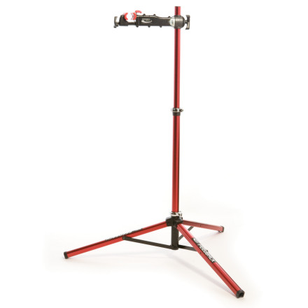 Fitness Feedback Sports designed the Pro Elite Bicycle Repair Stand to reign supreme as the premier full-function, professional grade, portable bike stand on the market. The Pro Elite features the patented Secure-Lock clamp which provides ratchet action closing and easy, push-button release so you can get bikes in and out of the stand quickly. This stand offers 360-degree rotation and its clamp opens all the way up to 2.6 inches to accommodate recumbent and other large-tubed frames. The Pro Elite quickly folds into a compact, 13-pound unit for storage or travel and the stiff tripod base design holds up to 85-pound bikes on any surface. - $239.99