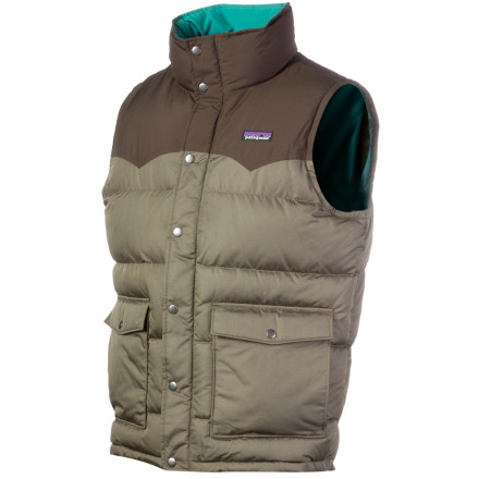 The Patagonia Mens Slingshot Down Vest recognizes that while you enjoy the freedom of going sleeveless, you still need to stay warm. Thats where the 600-fill goose down comes into play. This easy-on, easy-off puffy features full snaps down the front and boasts a drop-tail hem and DWR finish to shed precip. Patagonia rounded out the Slingshot vest with extra-soft brushed polyester at the collar, ensuring added comfort whether youre grabbing food downtown or just stuck out in the cold. - $89.40