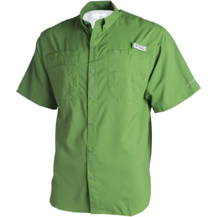 Flyfishing Pull on the Columbia Mens Tamiami II Short-Sleeve Shirt for a day of wading through trout streams and hiking along the river. This lightweight-fabric button-up offers some shade for your shoulders in the middle of a wide open river. It wicks sweat away while you hike in the sun and dries quickly in case you take a tumble and swamp your waders. A rod holder on the chest lets you change flies with both hands, and deep chest pockets leave room to stash gear when you dont want to wear a vest. - $26.97