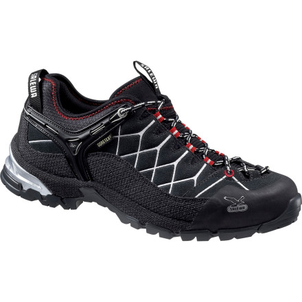 Camp and Hike Salewa mixed the stability and comfort of a lightweight hiking shoe with the technology and grip of approach footwear to create the Alp Trainer GTX Hiking Shoe. Hardcore ruggedness and comfort come together to give your foot a great ride whether you are sectioning the Pacific Coast Trail or stalking remote lines in the Sawtooths. - $76.03