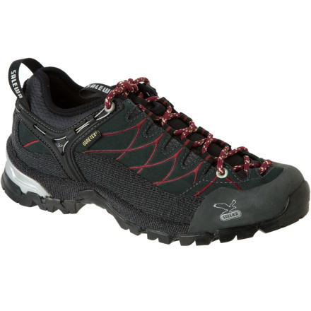 Camp and Hike Blur the lines between what is considered approach, backpacking, and hiking with the Salewa Women's Alp Trainer Hiking Shoe. Salewa calls it 'hike approach,' and the unique Alp trainer does it well due to the unbeatable ankle support of its 3F heel containment system. It features a steel wire that is anatomically positioned on the shell of the boot for the best hold and fit around. An elastic collar gives you a close, supportive fit, with no hot spots or blisters. - $62.53