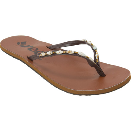 Surf Constructed with beads that are handmade by displaced women in Uganda, the Reef Women's Ugandal 4 Sandal provides you with a comfortable way to get about and a good feeling in your heart. The beads provide an income for these women to support their basic needs, are made with recycled paper, and are coated with a water-based lacquer for long-lasting wear. - $21.98
