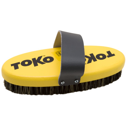 Ski Get the same brush used by racing teams around the world. The Toko Oval Copper Base Brush is for brushing out and cleaning dirty bases prior to waxing. It's also suitable for brushing out after Ahot waxing. 1/2 The Toko Oval Copper Base Brush's large contact surface guarantees evenly prepared bases. Toko's nylon strap provides optimal grip and allows efficient base work. - $37.46