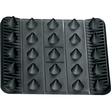 Snowboard If you want a super grippy stomp pad to slap on your board, go straight to the DAKINE Spike Stomp. The rubber spikes on this DAKINE pad hold your foot in place almost like a third binding. You can cut apart sections and reconfigure to your liking, too. - $7.96