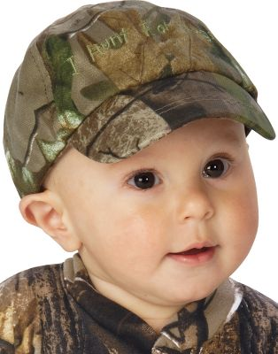 "Hunting Right now all your child hunts is a full bottle and their favorite blanket. But when they're wearing this hat, there's no doubt dad has bigger plans for them. Embroidery across the front says ""I Hunt for Hugs."" This cap is great for keeping the sun out of their eyes on warm-weather outings. Made of 50/50 cotton/polyester. Imported.Sizes: Infants' (18""), Toddlers' (20""). Camo pattern: Realtree APG . - $12.99"