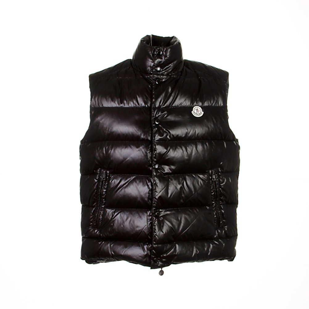 Ski Moncler Tib Vest - Since its creation, Moncler has become famous for its quilted jackets, ski and outdoor-wear. The Moncler Tib Vest adds to the collection of choices. Made from duck down, the collection provides you with warmth and a lightweight exterior that flows with style and design, taking you from the slopes to the village. For the ultimate in fashionable outerwear - Moncler is your superior choice. The Tib vest from Moncler is your puff vest with signature features, such as; lacquered nylon outer, high neck, and snap button and zip down front with logo patch on the chest for the Piece de resistance. Features: Snap-button, zip fly closure, Feather down lined. Material: Techno fabric, Category: Mid-Weight, Hood: No, Warranty: Other, Battery Heated: No, Type: Vests, Material: Synthetic, Pockets: 1-2, Model Year: 2013, Product ID: 286614 - $449.91