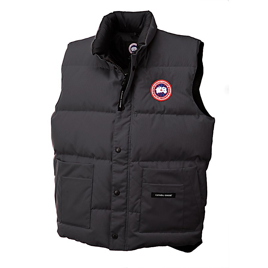 Ski Canada Goose Freestyle Vest - For fall or winter, the Canada Goose Freestyle Vest is a stylish and very warm choice for when you want to head outdoors. This vest is cut a little longer so that you can have added protection against the cold and wind. On the front side, there is a heavy-duty YKK Zipper that is shielded with a storm flap so that the howling frigid winds are blocked. You'll have some pockets that will allow you to keep a few things nearby. On top of that there are two fleece lined handwarmer pockets. A little style and a lot of warmth goes a long way when you wear the Canada Goose Freestyle Vest. . Insulation Weight: 625 Grams, Hood Type: None, Material: 85% Polyester, 15% Cotton, Fleece Weight: None, Hood: No, Warranty: Lifetime, Battery Heated: No, Type: Full Zip Top, Wind Protection: No, Type: Vests, Material: Synthetic, Pockets: 1-2, Wicking Properties: No, Type: Short Sleeve, Water Resistant: Yes, Model Year: 2013, Product ID: 291110 - $275.00