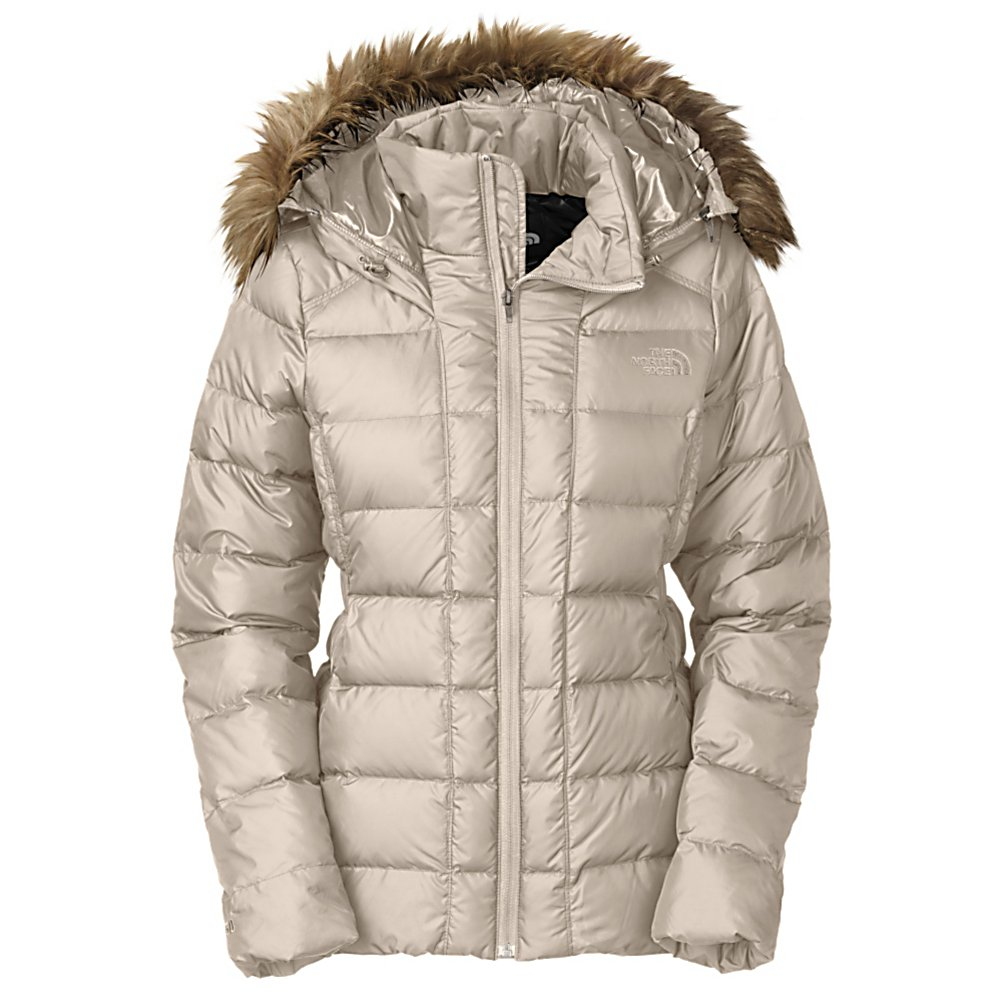 Ski The North Face Gotham Womens Jacket - When the weather gets super cold you are going to want a jacket that will keep you toasty warm. With that in The North Face has brought you the Gotham Insulated Jacket. The Gotham is insulated with 550 Fill Down insulation that will keep you toasty warm in all weather conditions. The exterior fabric is polyester with a DWR finish that will repel water to keep you dry as well. This jacket is super warm without the bulk and is compressible to make it easy to transport. There is an adjustable hood with to keep your dome protected from the elements and also features a stylish faux fur trim that can be removed should you not want that extra style. There is an internal media pocket on The North Face Gotham jacket that will allow you to jam to your favorite tunes while sporting the jacket. Ribbed cuffs and ribbed hem work will keep the wind out of the Gotham that adds to the warmth factor and two zippered hand pockets allow you to keep your hands toasty warm or store any small accessories you may need. Features: Embroidered Logo at Left Chest and Back Right Shoulder. Exterior Material: Polyester with DWR, Insulation Weight: Body: 550 Fill Down / Side Panels: 133g PrimaLoft One, Taped Seams: None, Hood Type: Fixed, Pit Zip Venting: No, Pockets: 1-3, Electronics Pocket: Yes, Goggle Pocket: No, Powder Skirt: No, Hood: Yes, Warranty: Lifetime, Use: Ski, Battery Heated: No, Race: No, Type: Insulated, Cut: Regular, Length: Medium, Insulation Type: Down, Cuff Type: None, Wrist Gaiter: No, - $230.00