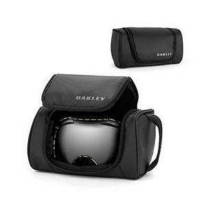 Snowboard Oakley Universal Soft Goggle Case - Keep your goggles protected during travel or not in use with the Oakley Universal Soft Goggle case. This nylon soft-shell case features a fleece lining to keep your goggles protected during your travels. Dual vent ports on the back allow for breathability to keep moisture out of the case to keep the lenses clear. A handy storage pocket on the inside gives you a place to store any additional items you may want to store. The Universal Soft Goggle case is easy to carry with the side carrying strap that is made of a durable nylon webbing. Features: Dual ports on back for breathability, Side carrying strap made of durable nylon webbing. Category: Goggle Cases, Model Year: 2013, Product ID: 257427 - $25.00