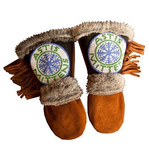Snowboard Astis Mittens Astis Womens Gloves - Displaying the Astis name and logo in beadwork, these leather mittens are a representation of The Astis Company. Honoring the original pair of mittens with inspiration, the name Astis is the Native American Cree word for mittens while the snowflake represents their love of winter. Astis leather mittens are hand-sewn in the USA from dark brown high-quality suede leather with hand-stitched beadwork on the gauntlet and are lined with Polartec Thermal Pro High Loft insulation. Astis has developed a suede leather, injected with silicon during the tanning process for further waterproofing, that is extremely durable yet retains great dexterity. The length and cut of their design allows for a jacket to slide fully inside without bunching while providing a close fit that protects the wrists and hands from snow in the heaviest of powder days. As each leather mitten is hand-sewn and uses natural materials, each leather mitten will possess slight variation in the look of the leather, beadwork, and fur trim. Astis embraces these subtle differences and views them as unique mittens more akin to works of art. . Removable Liner: No, Material: Leather, Warranty: Other, Battery Heated: No, Race: No, Type: Mitten, Use: Casual, Wristguards: No, Outer Material: Leather, Waterproof: Yes, Breathable: N/A, Pipe Glove: No, Cuff Style: Over the cuff, Down Filled: No, Model Year: 2013, Product ID: 298602 - $200.00