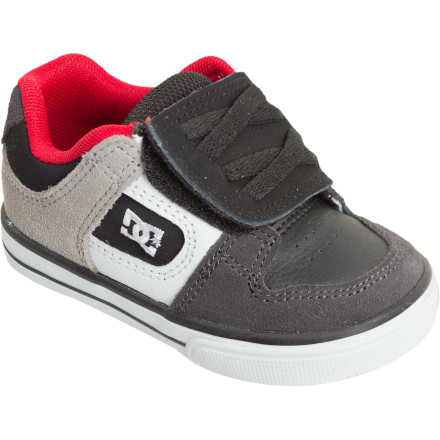 Skateboard Start your kidlet off on the right foot when you strap them into the DC Toddlers Pure V Skate Shoe. Strike while the impressionable style iron is hot as your grom or grommette tromps around in these DC kicks. The Pures convenient hook-and-loop strap helps your kid learn how to put shoes on. A suede upper, cup sole, and abrasion-resistant outsole withstand the wear-and-tear of your lil tornado. A foam-padded tongue and collar cushion little feet when your toddler stumbles. - $28.00