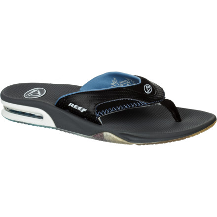 Surf When Mick Fanning isn't dominating the surf, he slips on the Reef Men's Fanning Premier Prints Sandal for the laid-back comfort a man needs after a hard day at the office. A heel airbag and arch-supporting EVA footbed keep things cush, while the clever bottle opener on the bottom of the sole keeps the chill going. - $32.97