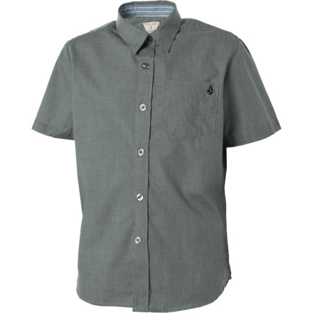 Surf Sure, he looks good when he buttons up the short-sleeve Volcom Boys' Ex Factor Solid Shirt, but when at the seafood shack he has to be careful not to eat any shellfish or he'll swell up and pop all the buttons off this fancy shirt. - $15.73