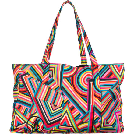 Surf When you ditch work in favor of the beach, trust your gear to the oversized Volcom Women's Rebellion Tote. The bright patterns are sure to draw stares, and the slip-in front pocket is a perfect stash for your phone, keys, or wallet. - $27.71
