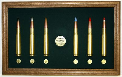 Hunting First coined by the G.I. in World War II, the Ma-Deuce display pays homage to the storied Browning machine gun a perfect gift for any military history buff. The plaque features six 50-cal. cartridges, each identified by color-coded tips. Cartridges included are the M-2 armor piercing, M-2 armor piercing incendiary, M-2 ball, M-1 incendiary, M-1 tracer and an M-20 armor-piercing incendiary tracer. Cartridges are professionally mounted and placed within a wood frame. Dimensions: 10.5H x 17W. - $134.99