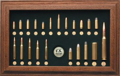 Guns and Military Spanning over 130 years of adopted ammunition by our United States Armed Forces, this cartridge collection includes a wide variety of handgun, rifle, shotshell and machine-gun calibers. The collection includes early black-powder Colt handgun ammunition, Springfields Trapdoors and Spencers repeaters that were tested by Abraham Lincoln himself. Other interesting finds include Roosevelts 30-40 Krag., World War I and II 30 Govt., .45 ACP and the feared 12-ga. trench gun of World War I, John Brownings. 50 BMG and much more. A one-of-a-kind gift that pays tribute to the greatest military in the world. Each cartridges is mounted in a handsome wood-framed plaque. 11.4H x 17.5W. Type: Cartridge Display Boards. - $139.99