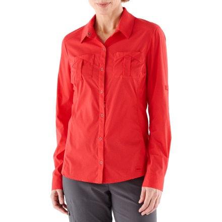 Camp and Hike The REI Larch Solid shirt looks great and functions as well on the mountain trail as it does on the urban trail. Lightweight nylon is blended with spandex for ample stretch, wrinkle resistance and wicking comfort. Performance knit side panels breathe and stretch for extra comfort. Fabric provides UPF 50+ sun protection, shielding skin from harmful ultraviolet rays. REI Larch shirt features snap-front placket, front and back princess seams and shirttail hem. Sun collar secures with button at collar point; flip it up when want sun protection on your neck. Roll-up sleeves secure with snap tabs. 2 small patch-on chest pockets and small security pocket with hidden zipper. Slim fit offers a lean look. - $40.93