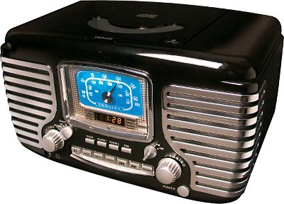 "Entertainment Styled like a 1950's classic automobile, the Corsair Clock/Radio has enough chrome and features to get you'revved up and rolling. Besides a vintage appearance, it offers modern-day features such as an AM/FM radio alarm clock with digital readout and dynamic, full-range stereo speakers. It houses a CD player with a programmable 20-track memory and dual alarms that can be set and used independently. You can even opt to wake to CD, radio or buzzer. Other features include repeat and random play, snooze and sleep, LED display, analog tuning, function select, an external antenna and a headphone jack. Dimensions: 7""H x 11.25""W x 7""D. Weight: 5 lbs. - $99.99"