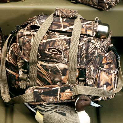 Hunting Not only will Drake Waterfowl Systems Floating Blind Bag protect contents from external moisture, it will also float if dropped in water ensuring your gear is always protected. It doubles up the protection with a seam-welded vinyl internal liner and five panels of closed-cell flotation foam and padding. Exterior is rugged, water- and abrasion-resistant PVC-backed 900-denier polyester. Exterior pockets have shell loops and choke-tube holders. Open one up and the first thing you see is a removable clear-vinyl see-through zippered map pocket providing instant access to your WMA maps, topo maps, sunrise/sunset charts and other important information. Light-reflecting interior aids you in locating contents easier. Multiple storage pockets line the walls of the bags to eliminate the frustration of sorting through a jumbled mess to find what you need. Organization options are almost limitless with 18 storage pockets on the large bag and 20 on the extra-large. Youll appreciate having the thermos/jacket sleeve on the top during chilly morning hunts (thermos not included). The left end has a large shell pocket with elastic opening. On the right end is a large, waterproof gear pocket with a flap top. Imported. Sizes: Large 18W x 11H x 10D. Extra-large 20W x 12H x 11D. Camo patterns: Mossy Oak Shadow Grass Blades, Realtree MAX-5, Mossy Oak Shadow Branch. Size: MAX 5. Color: Xlarge. Type: Blind Bags. - $69.99