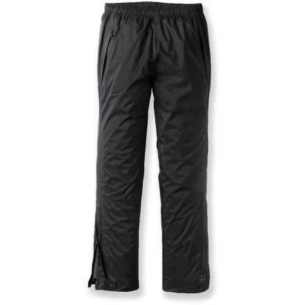 The men's REI Rainwall pants with a 34 in. inseam offer full-featured, waterproof breathable protection. Keep them in your pack, your car or your bike pannier for sudden changes in the weather. Rainwall pants pack into their own pocket for easy, compact storage. Lightweight 2.5-layer ripstop nylon is waterproof, breathable and windproof to 60 mph; seams are sealed for complete protection. Drawcord waistband personalizes the fit. Articulated knee darts allow comfortable range of motion with no tugging. Lower legs have zipper openings for easy on/off; hem drawcord cinches hems down securely over boots. Zippered, front hand pockets feature bonded flaps for protection from moisture. REI Rainwall pants have an easy-layering classic fit. - $54.93